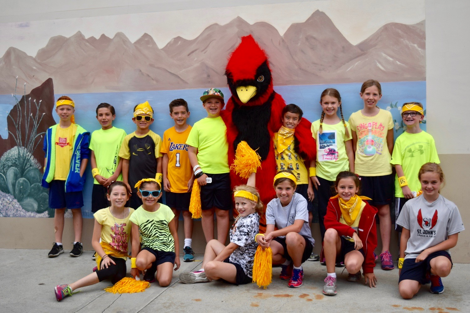 students standing with Cardinal mascot
